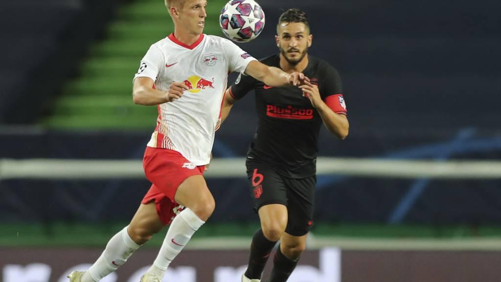 Leipzigs Torschütze Dani Olmo (links) gegen Atléticos Koke