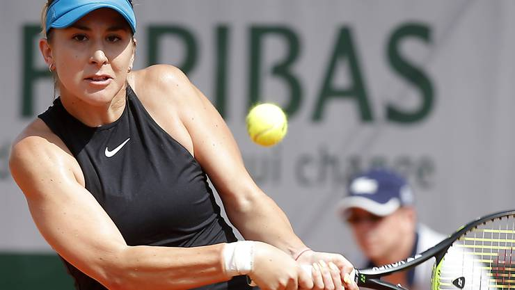 Belinda Bencic of Switzerland returns the ball to Slovakia's Magdalena Rybarikova during their second round match of the French Open tennis tournament at the Roland Garros stadium, Thursday, May 31, 2018 in Paris. (AP Photo/Michel Euler)