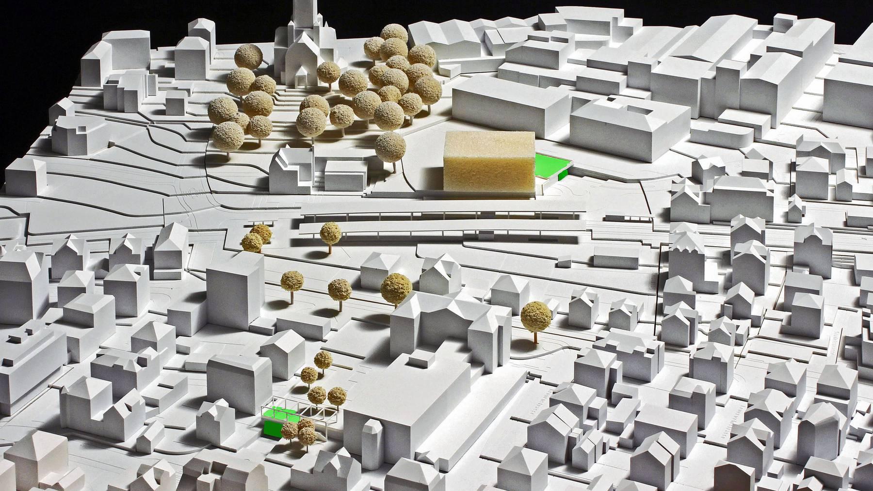 So soll das Stadtzentrum künftig aussehen. In der Mitte der Bahnhof, die geplante Unterführung ist grün eingezeichnet.