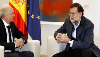 Der venezolanische Oppositionsführer Antonio Ledezma (links) im Gespräch mit dem spanischen Regierungschef Mariano Rajoy am Samstag in Madrid.