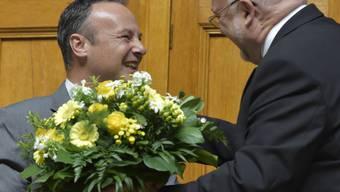 Ruedi Lustenberger (r.) gratuliert Stéphane Rossini