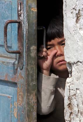 Ein wenig schüchtern: Kirgisischer Bub.