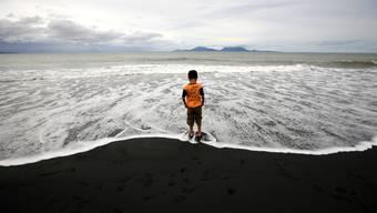Tausende gedenken der Tsunami-Opfer
