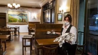 Restaurants wie das Cafe Romand in Lausanne empfangen ab dem 10. Dezember wieder Gäste - mit Gerichten und Musik.