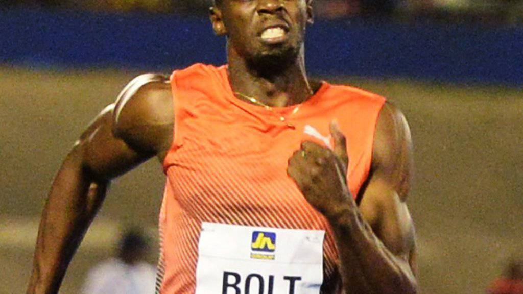 Usain Bolt muss auf die Zähne beissen, setzt sich aber klar durch
