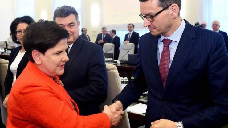 Beata Szydlo und Mateusz Morawiecki am Donnerstag in Warschau vor der Kabinettssitzung.