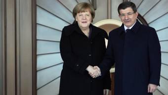 Angela Merkel, Ahmet Davutoglu: Enge Zusammenarbeit vereinbart.