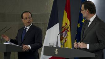 Fordern eine Bankenunion: Hollande (links) und Rajoy in Madrid
