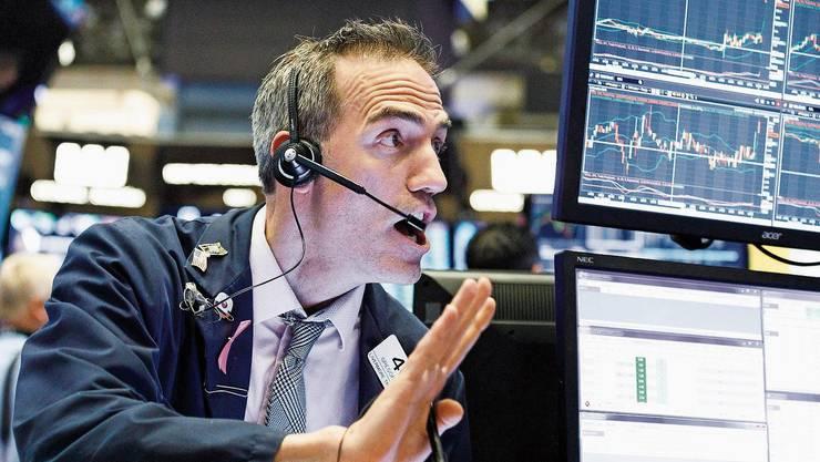Ein Händler in New York: Auch in den USA ist die Börse auf Talfahrt.