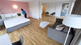 Im luxuriösen «Hotel des Patients», das dem Unispital Lausanne angegliedert ist, können auch Allgemeinversicherte ohne Aufpreis logieren.