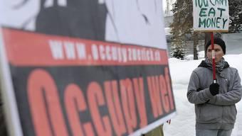 Geld kann man nicht essen: Occupy-WEF-Demonstration in Davos