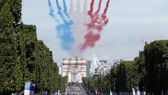 Nationalratspräsident Dominique de Buman wohnt der Parade zum französischen Nationalfeiertag am 14. Juli in Paris bei. (Archiv)