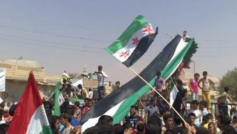 Regimegegner bei einer Kundgebung vom Freitag in Aleppo