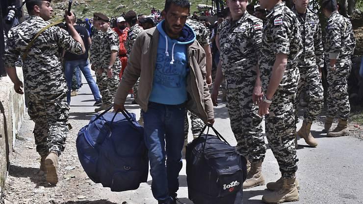 Ein syrischer Flüchtling im Libanon auf dem Rückweg in sein Heimatland. (Archivbild)