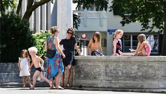 Stadtkinder baden im Stachelschützen-Brunnen am Spalengraben. Sie zeigen: Es braucht nicht immer Spielplätze, um kinderfreundlich zu sein.Foto: Juri Junkov (23. Juli 2019)