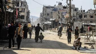 Ost-Ghuta vor den Toren von Damaskus, ist zu grossen Teilen zerstört. Wer geflohen ist, muss innert 30 Tagen persönlich erscheinen, sonst wird er enteignet.