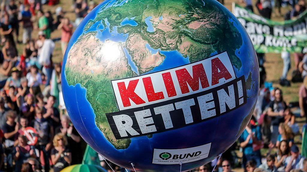 Eine Begrenzung der Erderwärmung auf 1,5 Grad im Vergleich zum vorindustriellen Niveau ist durch «schnelles und weitreichendes» Handeln erreichbar - dies ist eine der Kernaussagen des jüngsten Sonderberichts des Weltklimarats IPCC (Symbolbild).