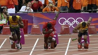 Usain Bolt (links) startet am 100-Meter-Final der Männer an der Sommerolympiade von London.