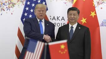 China unter der Führung von Präsident Xi Jinping hat eine Reihe von US-Journalisten ausgewiesen - auch, weil sich US-Präsident Trump abfällig über das Reich der Mitte geäussert hat. (Archivbild)