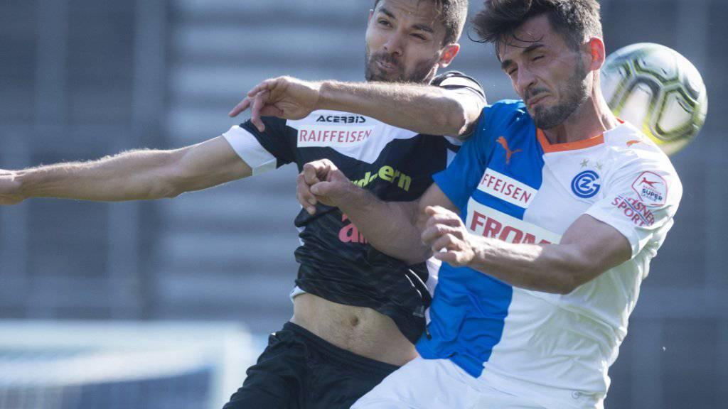 Der GC-Verteidiger Bujar Lika im Zweikampf mit Luganos Captain Jonathan Sabbatini