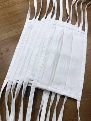 Das sind die Leinenmasken von Schönbächler.