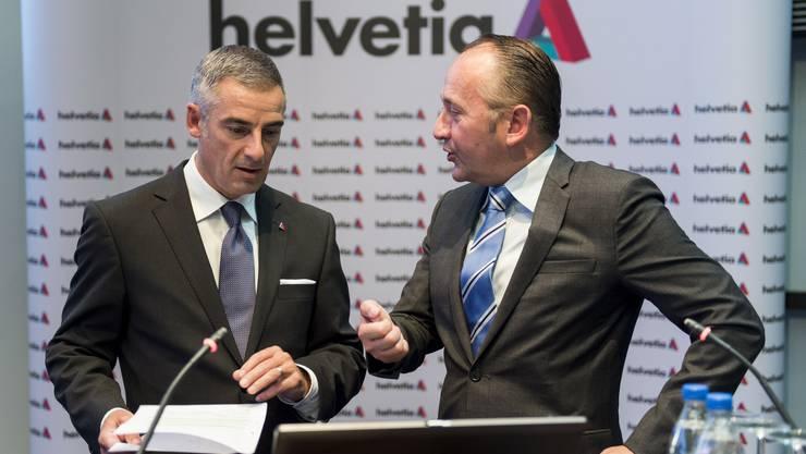 Hans Kuenzle, CEO Nationale Suisse, mit Stefan Loacker, CEO von Helvetia.