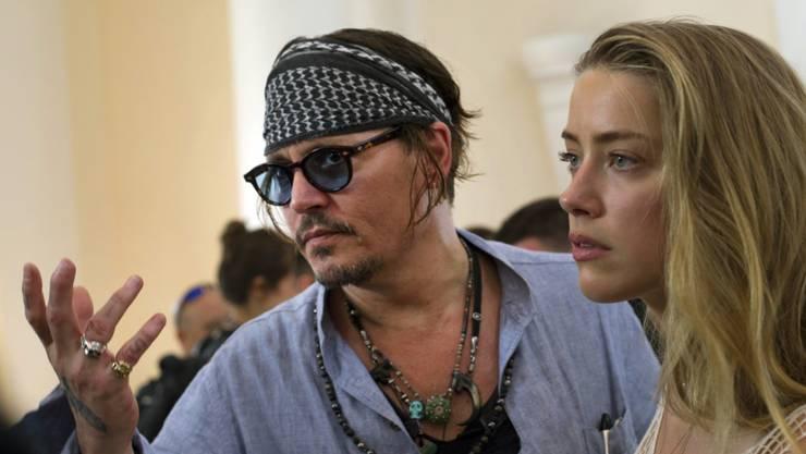 Auf dem Hund: Schauspieler Johnny Depp und seine Frau Amber Heard haben in Australien juristischen Ärger. (Archiv)