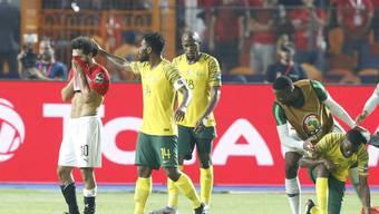 Mohamed Salah (links) und Ägypten verzweifeln: Der Gastgeber ist bereits out