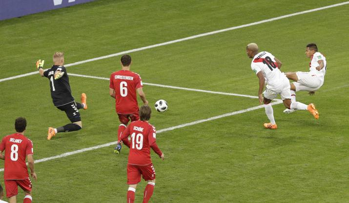 Denmark goalkeeper Kasper Schmeichel, left, makes a save during the group C match between Peru and Denmark at the 2018 soccer World Cup in the Mordovia Arena in Saransk, Russia, Saturday, June 16, 2018. (AP Photo/Gregorio Borgia)