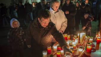Einwohner von Daillon gedenken der Opfer.