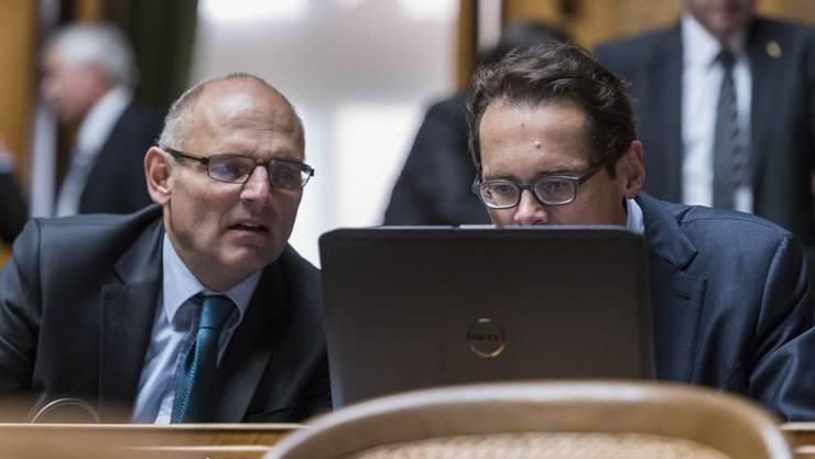 Social Media wird für Politiker immer wichtiger. Im Bild: Alfred Heer und Roger Köppel.