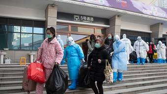 Immer mehr Menschen in China können die Spitäler wegen einer Heilung der Coronavirus-Infektion verlassen.