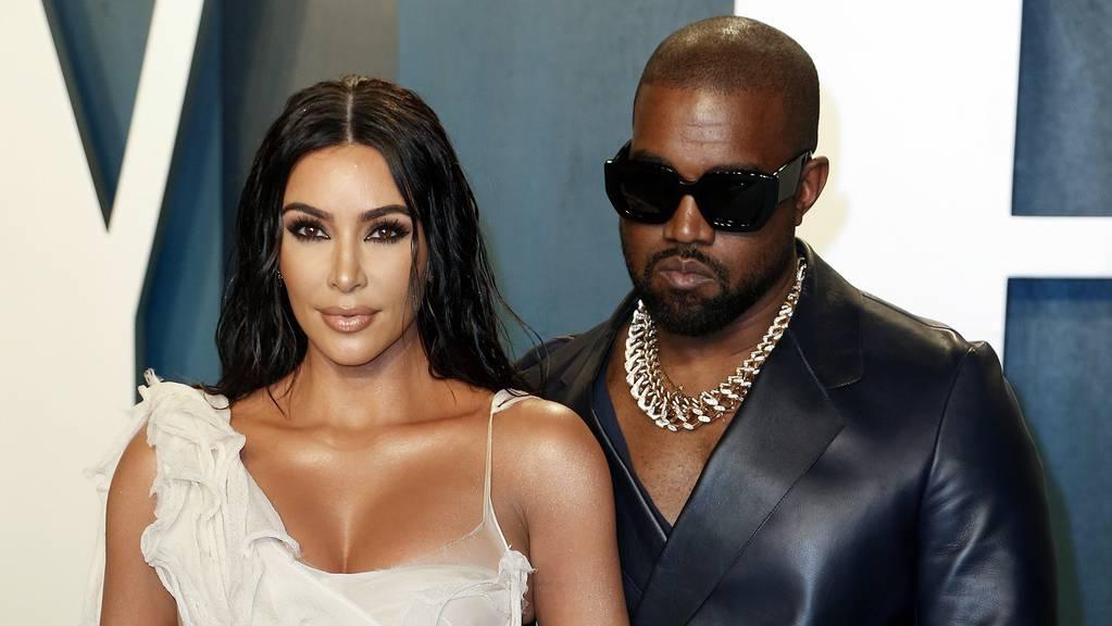 Kanye West (rechts) mit seiner Ehefrau Kim Kardashian.