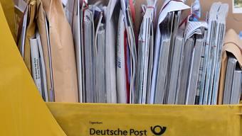 Trotz Streik: Laut der Deutschen Post erreichen rund 87 Prozent der Briefe und rund 84 Prozent der Pakete ihre Empfänger pünktlich (Archiv)
