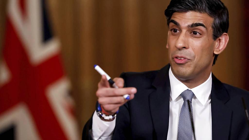 Der britische Finanzminister Rishi Sunak will die Machbarkeit einer von der britischen Zentralbank gestützten Cyberdevise, den «Britcoin», prüfen. Die Währung soll als Ergänzung zum britischen Pfund von Haushalten und Firmen genutzt werden.(Archivbild)