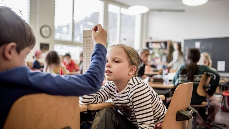 Die Deutschschweizer Kantone wollen mit dem Lehrplan 21 die Schulsysteme harmonisieren.