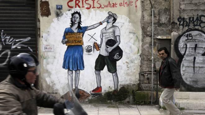 Graffiti in Athen gegen den von der EU verlangten Sparkurs in Griechenland. Foto: Keystone/AP/Thanassis Stavrakis