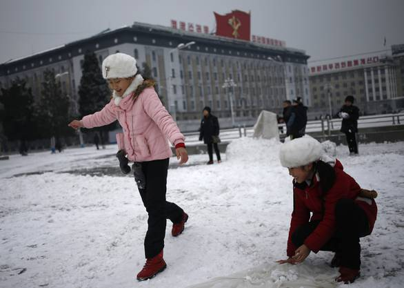 North Korean girls play with the snow on Kim Il Sung Square in Pyongyang, North Korea, where the winter season has started, on Sunday, Dec. 16, 2018. (AP Photo/Dita Alangkara)