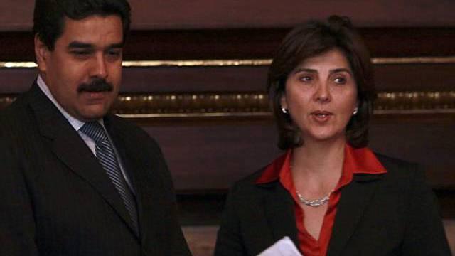 Die Aussenminister Kolumbiens u. Venezuelas, Holgin (r.) u. Maduro