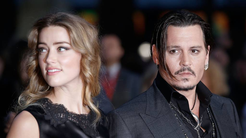 """Amber Heard and Johnny Depp attend the """"Black Mass"""" Virgin Atlantic Gala screening during the BFI London Film Festival, at Odeon Leicester Square on October 11, 2015 in London, England.  (Photo by John Phillips/Getty Images for BFI)"""