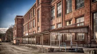 In leer stehenden Gebäuden der alten Textilfabrik DMC in Mulhouse sollen Ateliers mit neuen Formen von Arbeitsplätzen entstehen.