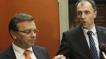 Roberto Schmidt (links) und Christophe Darbellay (Archiv)