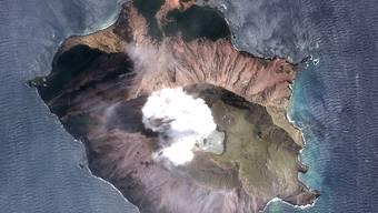 Auf der Vulkaninsel White Island vor Neuseeland befinden sich nach einer Eruption wohl noch immer acht vermisste Menschen.