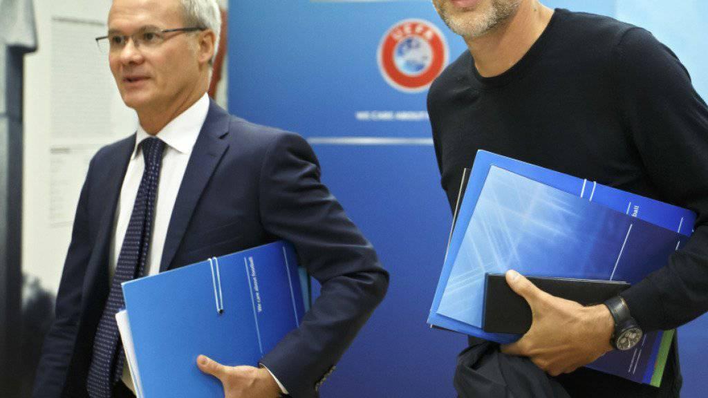 UEFA-Wettbewerbsdirektor Giorgio Marchetti (links) und PSG-Trainer Thomas Tuchel am Dienstag in Nyon