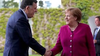 Die deutsche Kanzlerin Angela Merkel hat den libyschen Regierungschef Fajes al-Sarradsch im Kanzleramt empfangen.