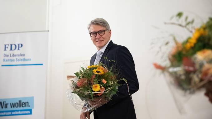 Markus Schüpbach mit Blumenstrauss nach der Nomination.