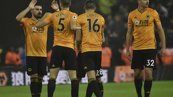 Die Spieler von Wolverhampton jubeln nach dem überraschenden Sieg gegen Manchester City