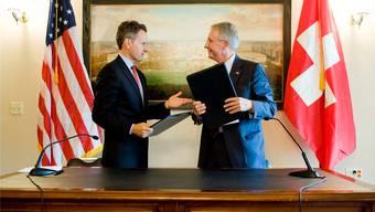 Was ist die Unterschrift der Amerikaner noch wert? Im Bild: Unterzeichnung des jüngsten Doppelbesteuerungsabkommens 2009 in Washington.