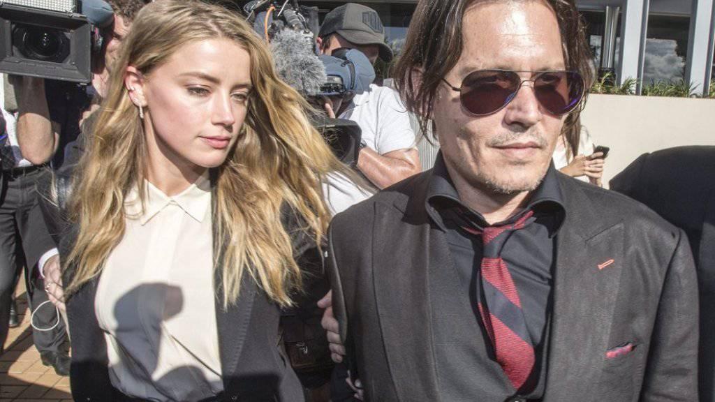 Die gegenseitigen öffentlichen Schuldzuweisungen wurden ihnen zu viel: Amber Heard und Johnny Depp haben sich im Stillen geeinigt. (Archivbild)