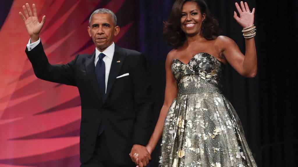Ex-Präsident Barack Obama und seine Frau Michelle bei einem Dinner im September 2016. Das Ehepaar hat einen gemeinsamen Buchvertrag in Millionenhöhe abgeschlossen.